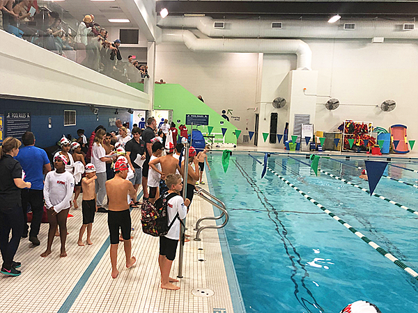 Dolphins Swim Club stretches at the Hall of Fame Etobicoke Swim Meet October 19th 2019