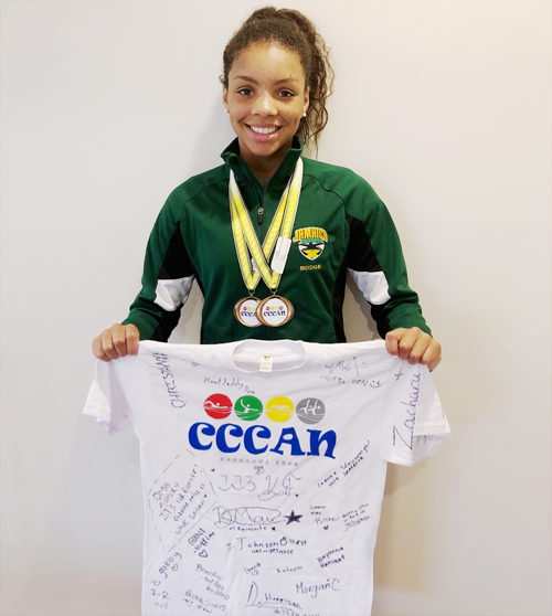 Ashley Hodge from the Dolphins Swim Club of Burlington and Oakville wearing her two medals from CCCAN BARBADOS 2019