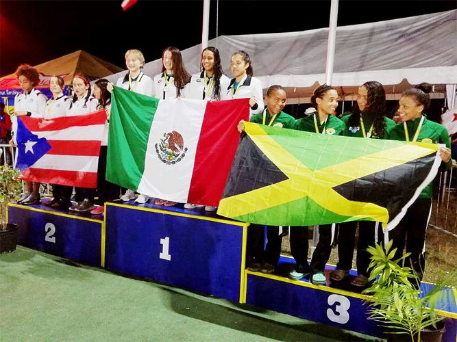 Ashley Hodge from Dolphins Swim Club of Burlington and Oakville at CCCAN Barbados 2019 standing on the Podium representing Jamaica