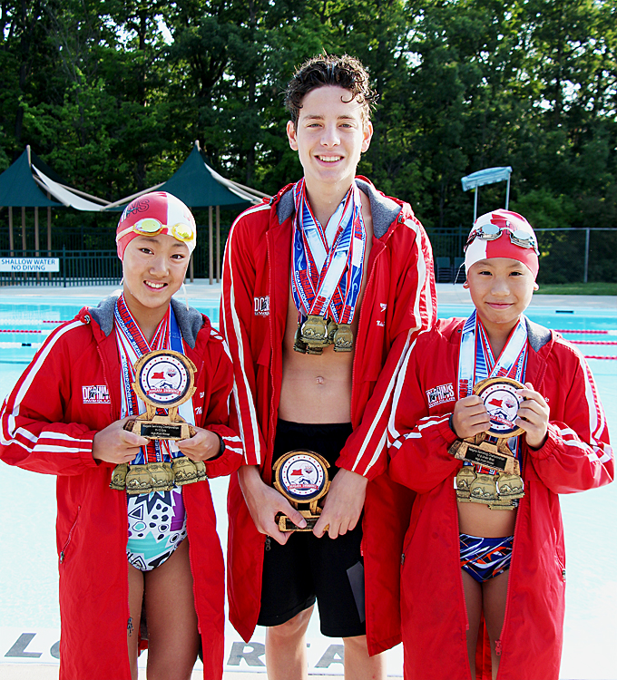 Dolphins Swim Club swimmers Melissa Er, Aly El Shamy, Aidan Lee show off medals and highest point awards from Niagara Championships 2019