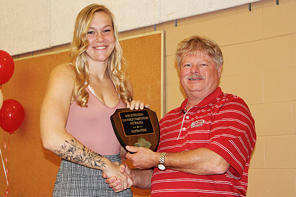 Kristina Steins of the Dolphins Swim Team of Burlington recieves an award for best overall performance