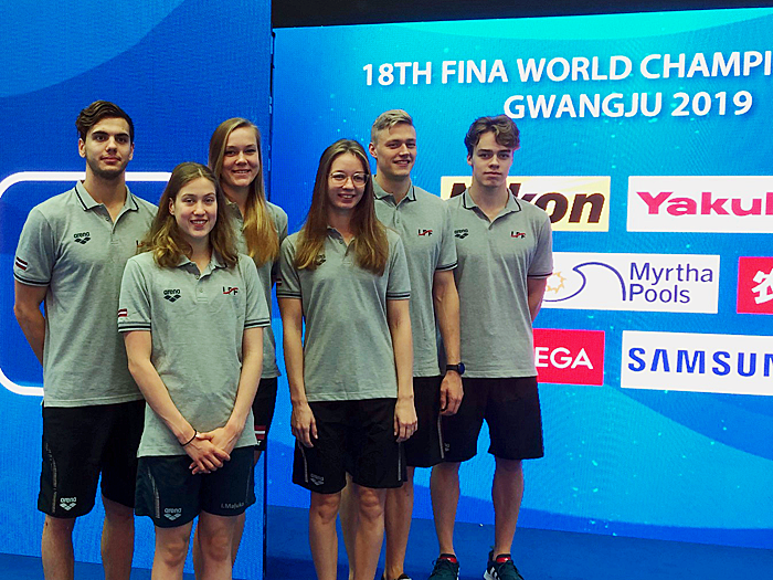 Kristina Steins of the Dolphins Swim Team of Burlington stands with her relay team at the 2019 Fina World Championships